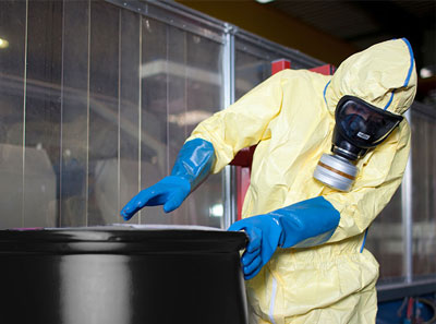 Man wearing chemical protective suit