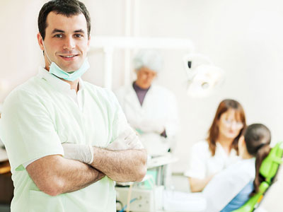 Dental: A dentist supervising a medical procedure